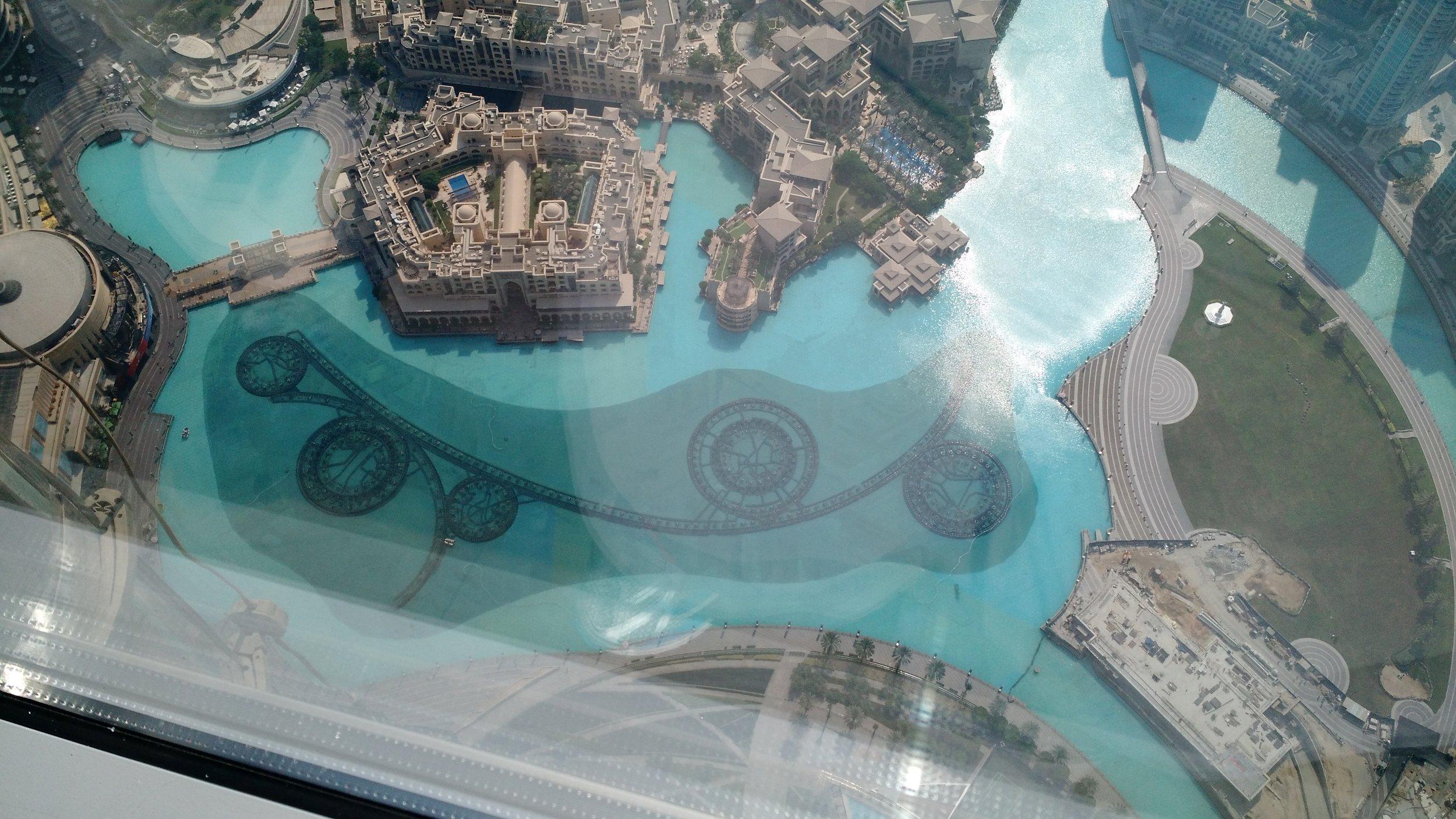 Dubai Fountain jet alignment; seen from Burj Khalifa At The Top viewing deck