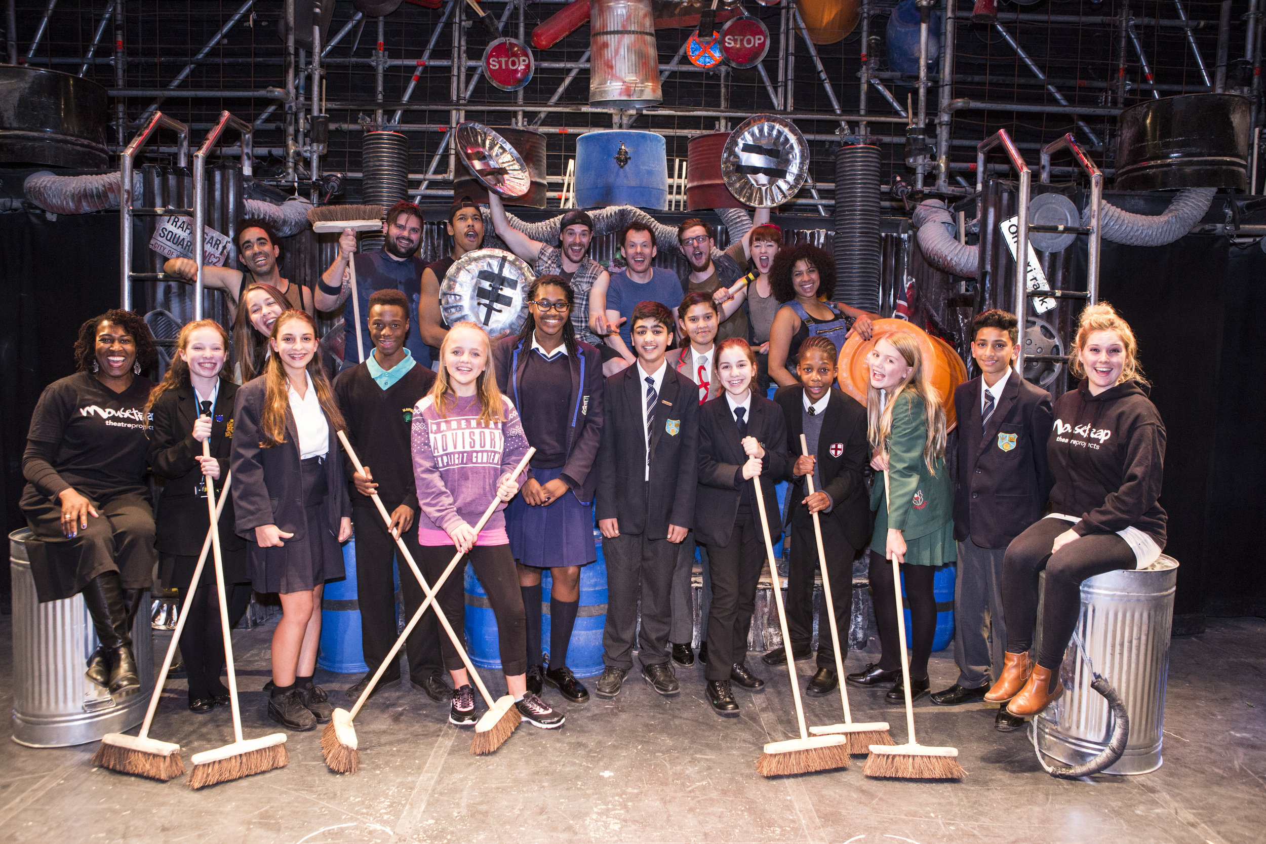 Elaine Grant (far left) and Ellie Shaw (far right) from Mousetrap Theatre Projects, with students and the cast of STOMP credit Luke Varley.jpg