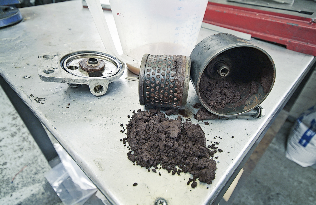 When you discover a fuel filter this badly clogged you naturally fear the worst. It's amazing the car ran at all