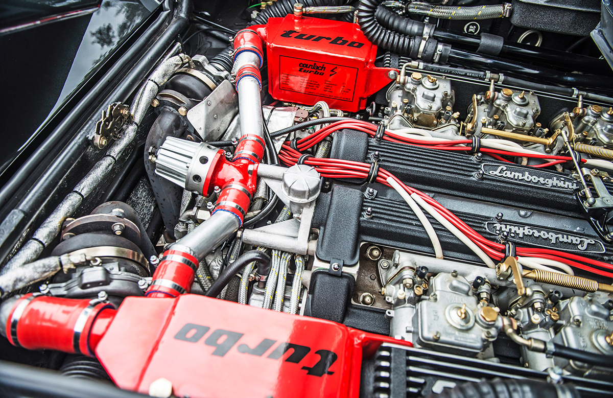 A peek into the engine bay leaves no doubt as to this 4754cc V12's aspiration