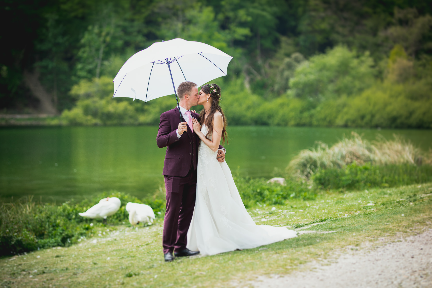 Bride and Groom Kiss in the Nature
