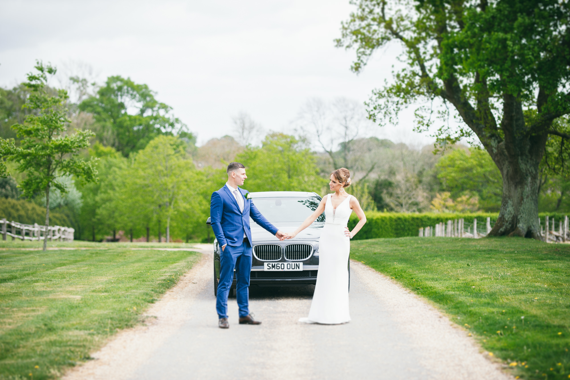 BMW, Bride and Groom holding hands wedding Sussex photography