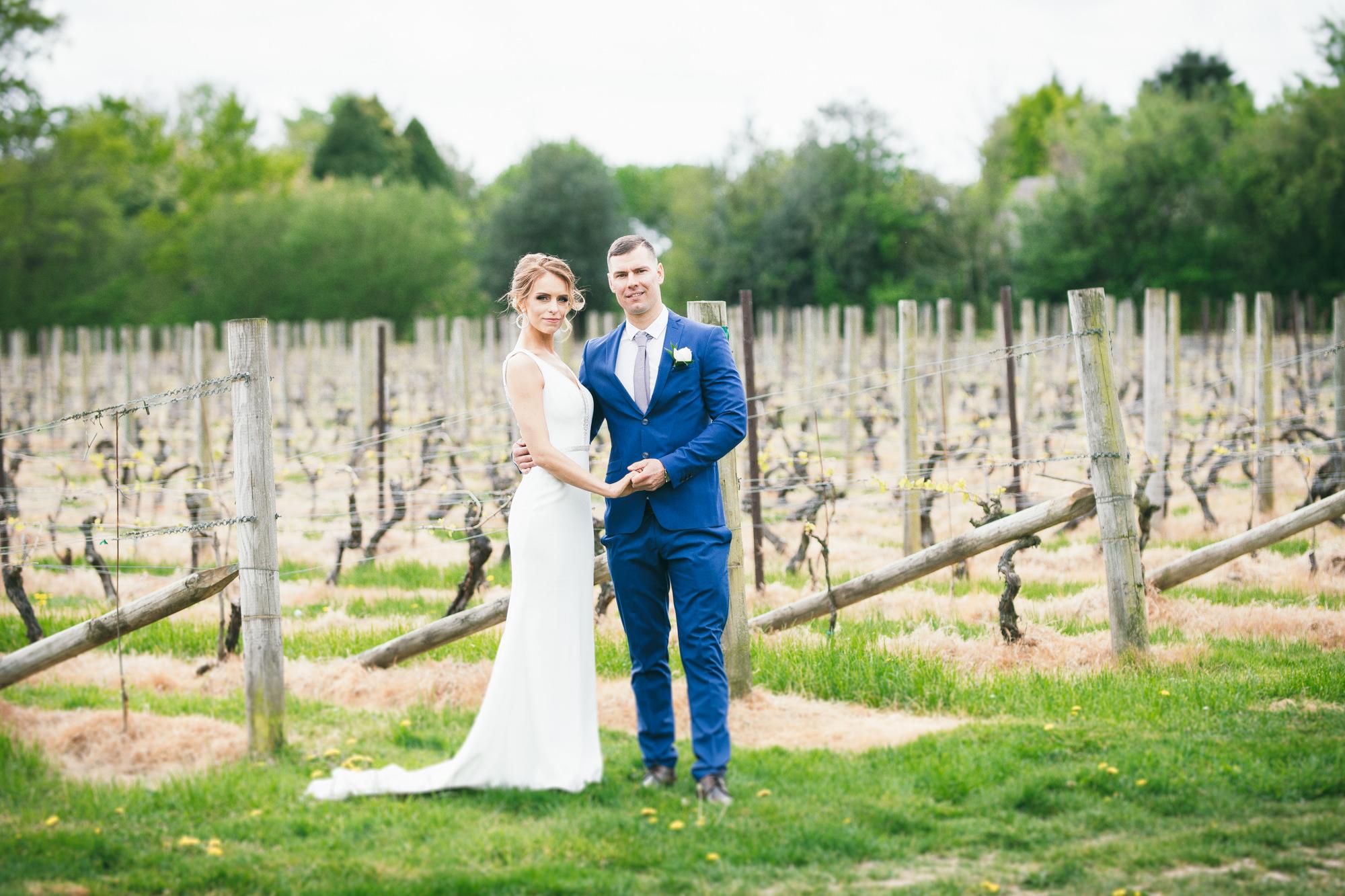 Bride and Groom Wedding Portrait under the tree near Nyetimber Vineyards Sussex
