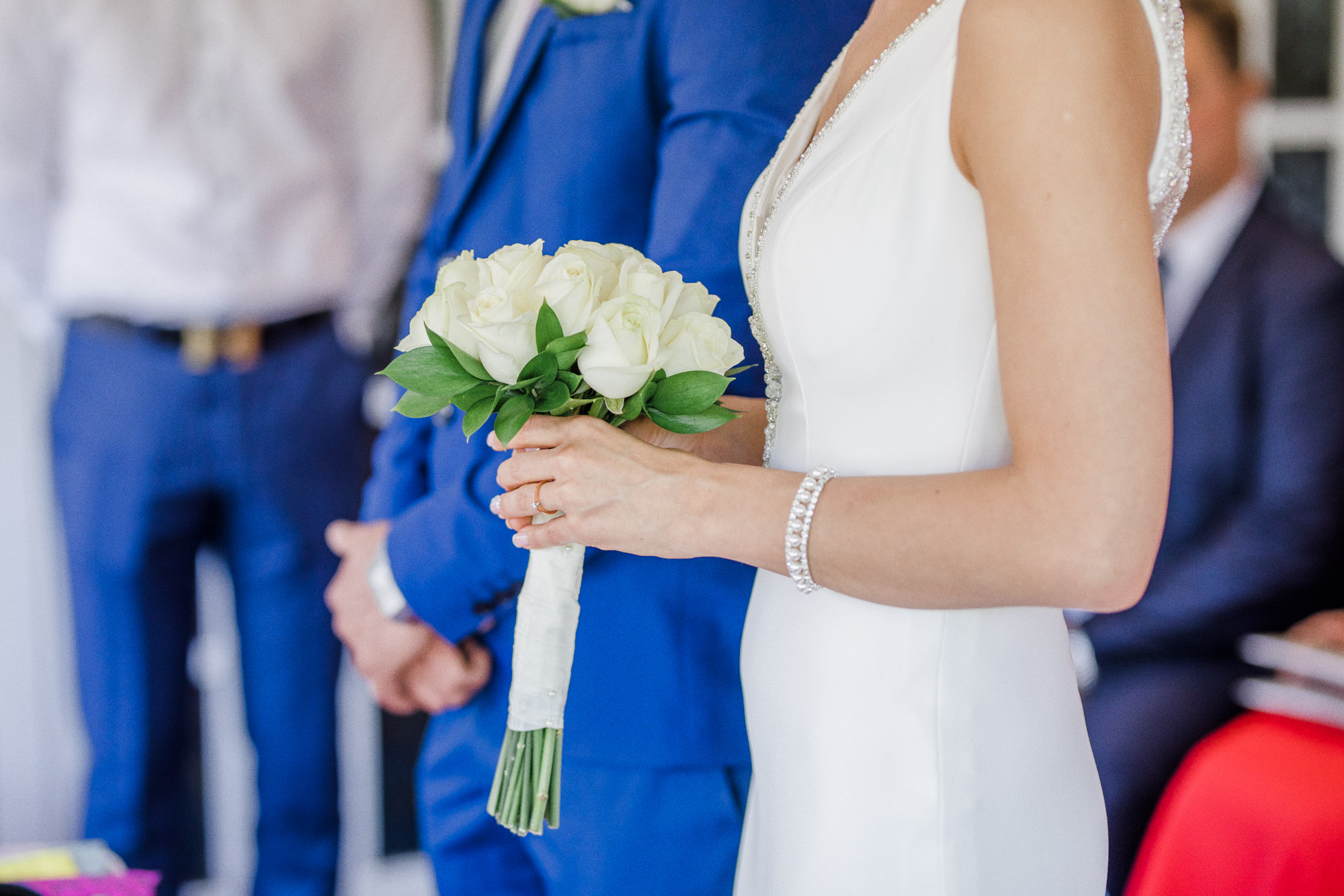 Bride holding bouquet of flowers in Worthing Hotel