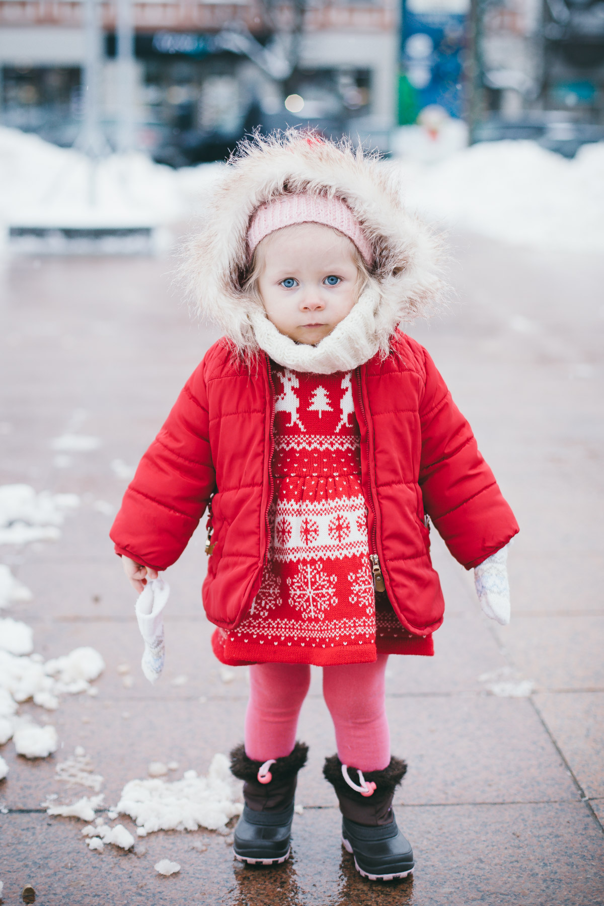 Little Girl in Red Coat Looking at the Camera
