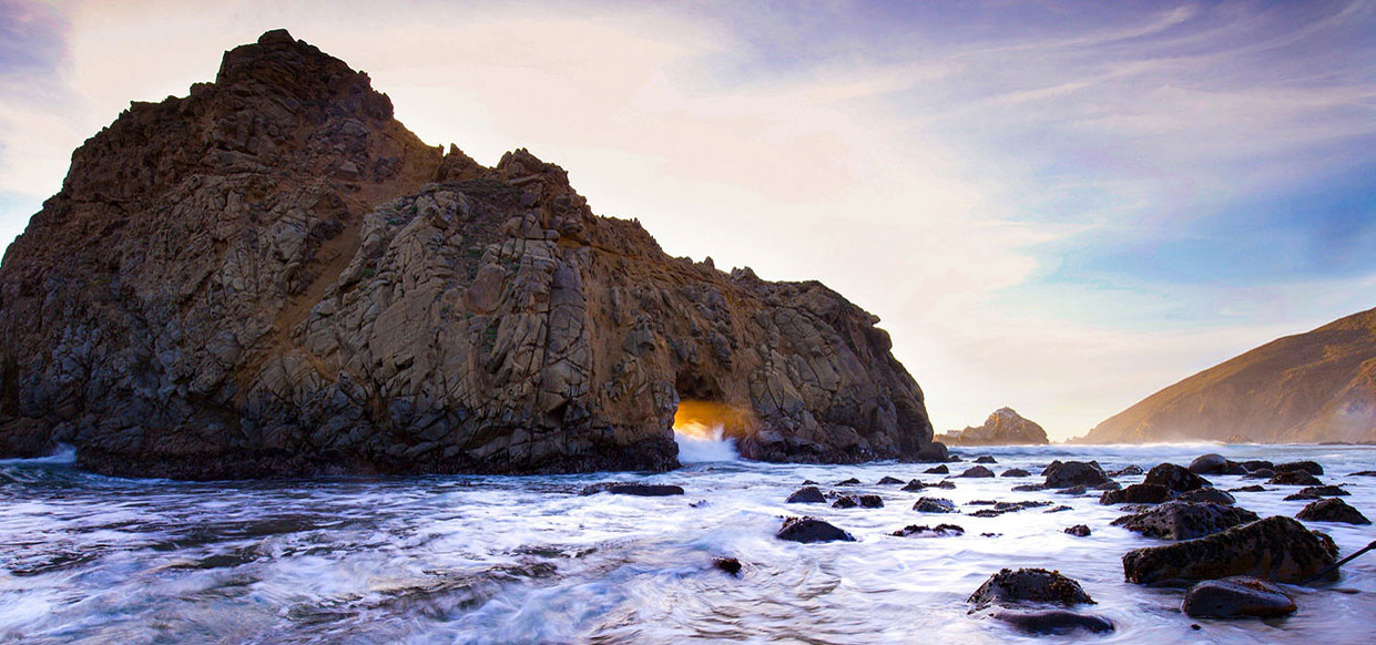 An ocean vista of swirling tide and craggy rocks