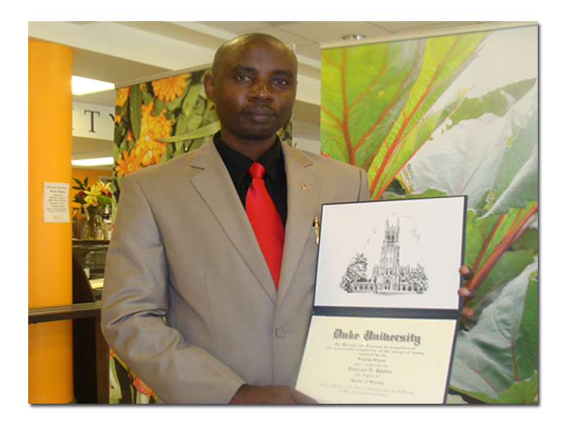 Holding my diploma from Duke Divinity School