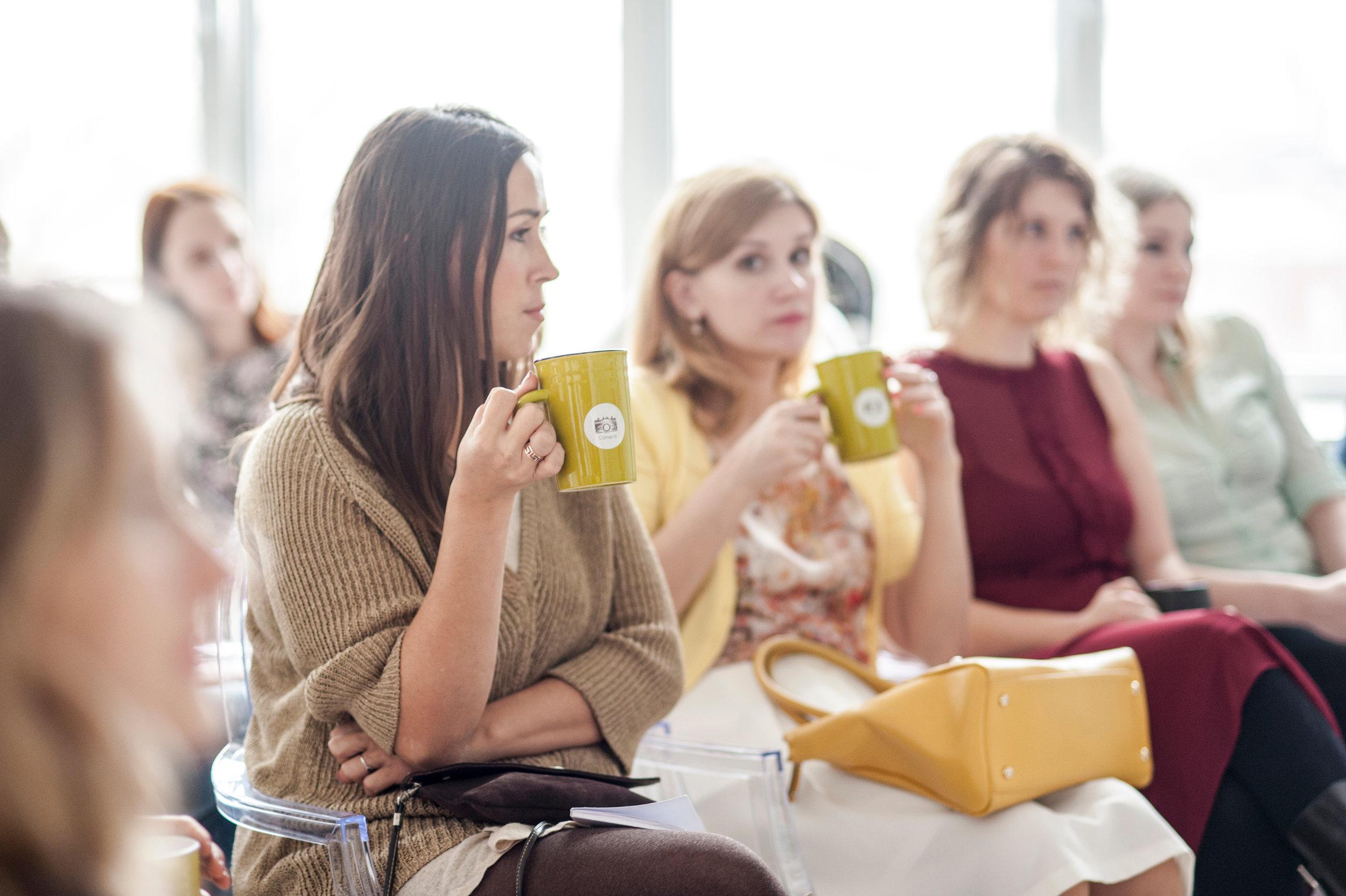 Canva - Woman Wearing Brown Corduroy Coat Holding Mug While Sitting on Chair.jpg