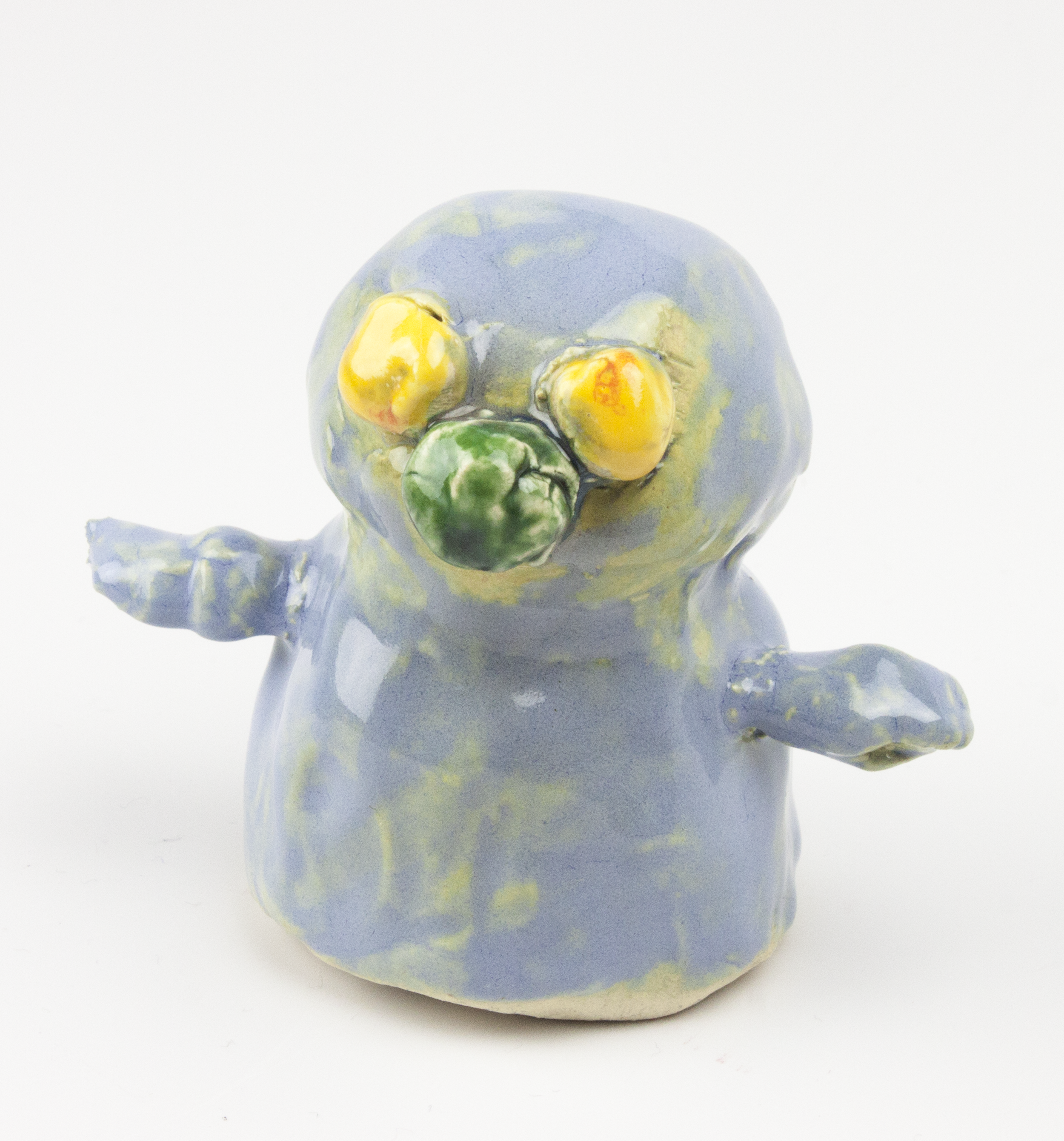 Blue Man, Yellow Eyes . White stoneware clay, oxidation fired to Cone 5.