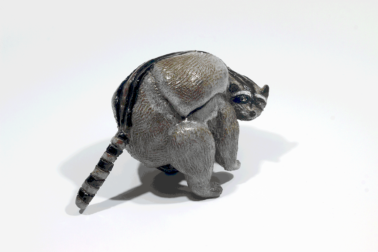 Raccoon attack . Alternative view 2. Stoneware with commercial glazes.