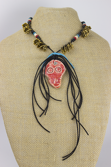 Necklace made and modeled by Jen. Includes ceramic skull pendant,wooden beads, metal flower beads, and nylon string.