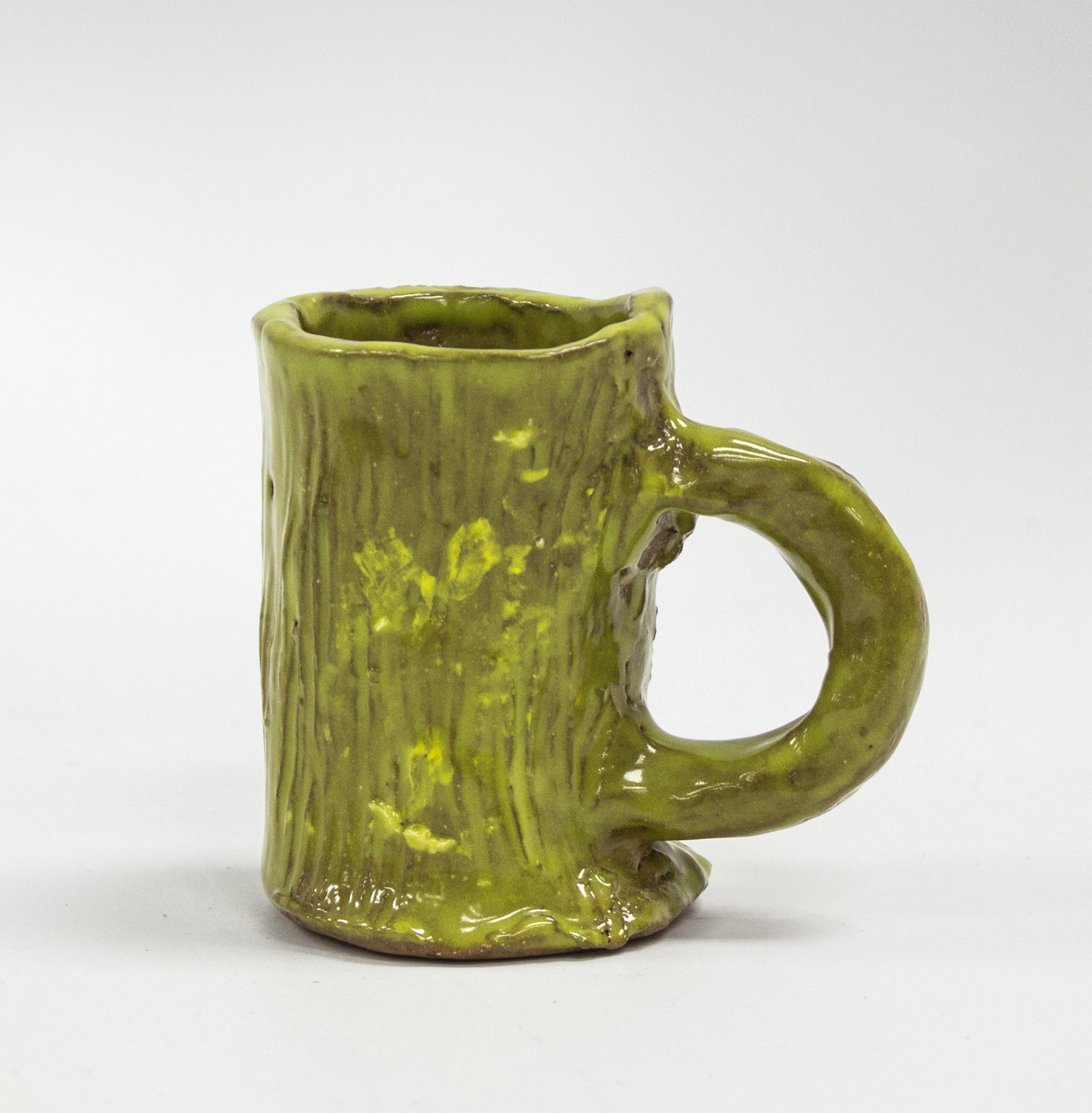 "Green Mug.  Earthenware with commercial glazes. 2.5"" x 2.375"" x 3.375""."