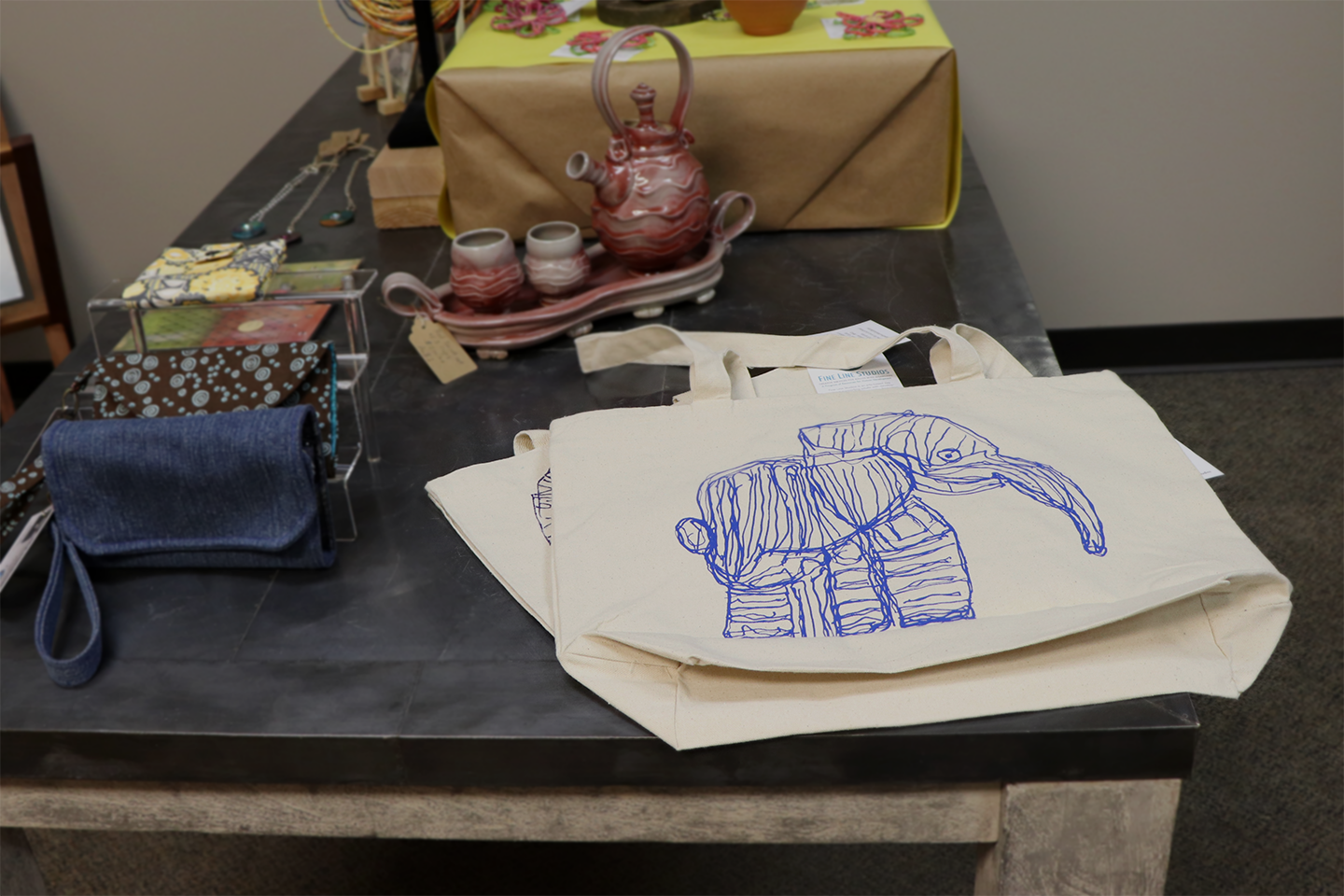 "Roxie Tomek's ""Baby Elephant"" tote bags for sale at the St. Louis Artists' Guild!"