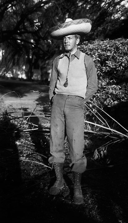 Vintage photo of young man in old clothes and sombrero