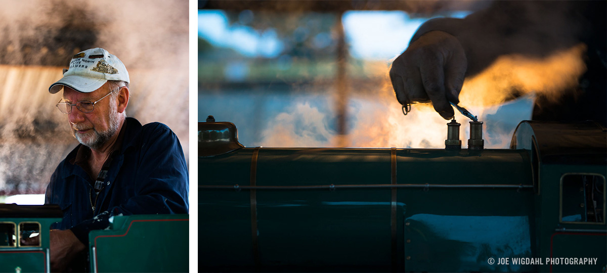 Portrait of small scale train conductor repairing steam train.