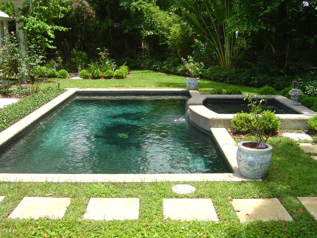 After - paver walkway, beautiful plantings, and new sod make this pool attractive