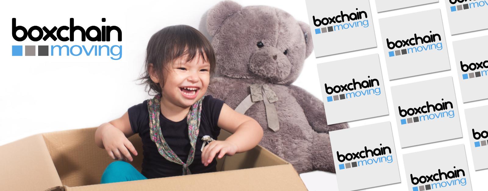 Boy sitting in a box with a teddy bear
