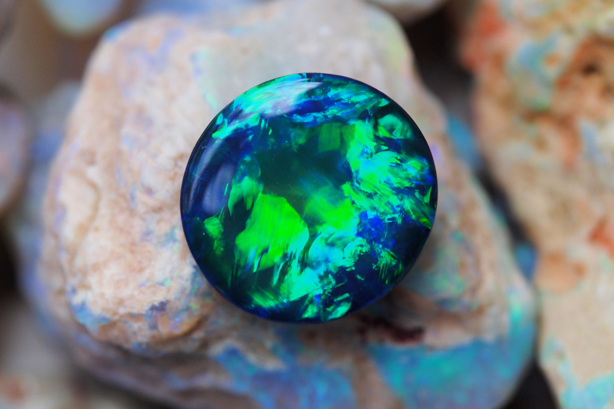 Black Opal - Found mainly at the opal fields of Lightning Ridge, NSW, Black Opal is the most magnificent and valuable type of Australian opal. Ablaze with vibrant colour, this high quality gemstone is extremely rare and can be distinguished by the darkness of its background body tone or body colour, which ranges from dark grey to jet black.