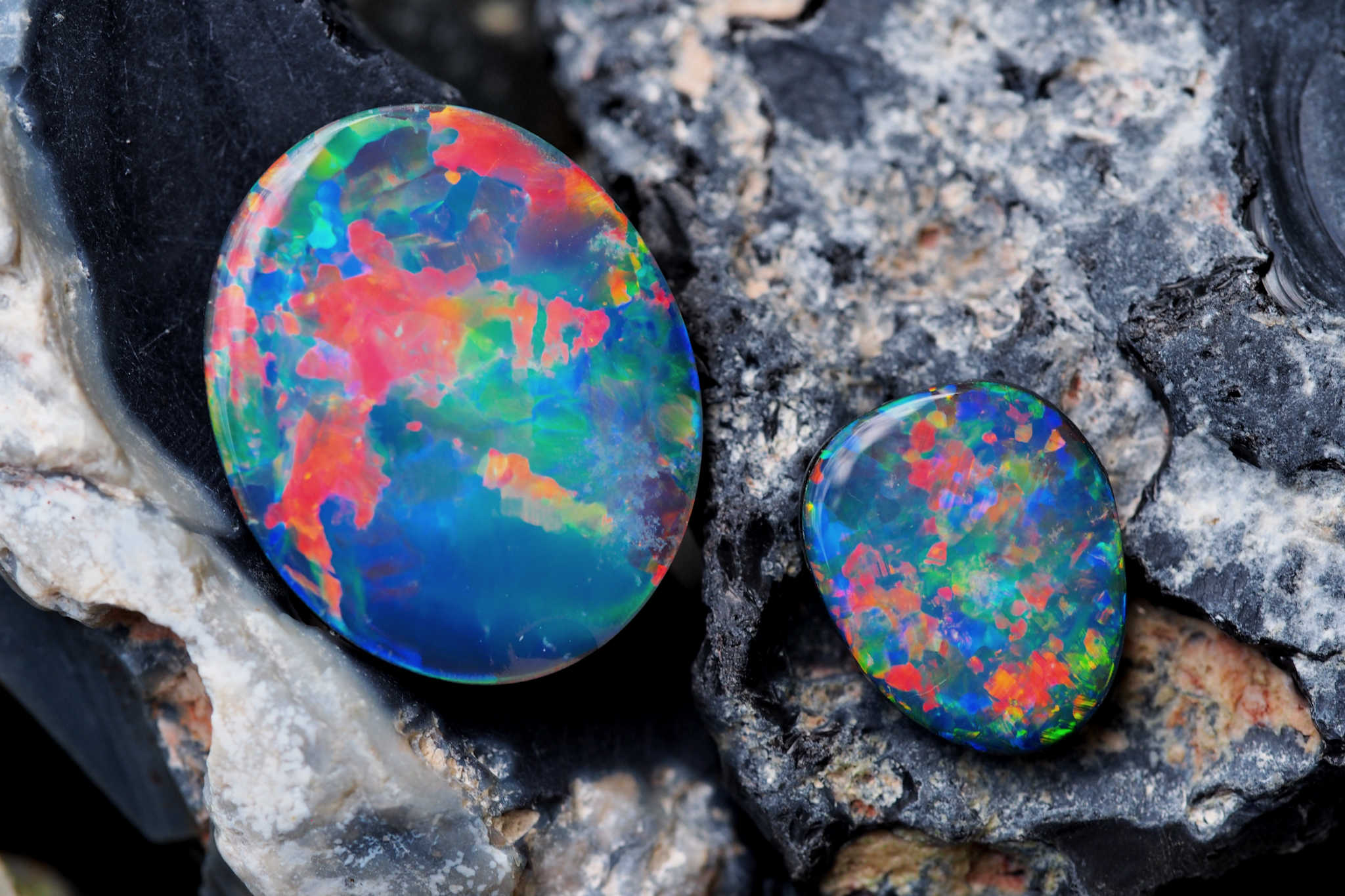 Doublets & Triplets - Doublet and Triplet Opals are composite stones that contain a thin slice of colourful, natural opal. Doublet opals are set against a layer of dark potch, while triplet opals also feature a clear domed quartz crystal cap. Doublet and triplet opals can be an affordable alternative to purchasing a solid black opal.