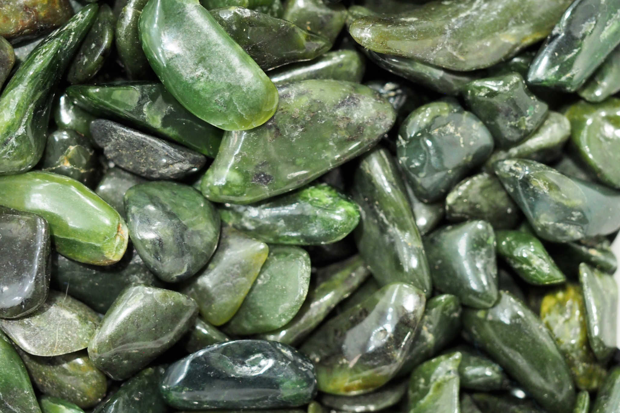 NEPHRITE JADE - An ornamental stone used in carvings, beads, or cabochon cut gemstones for centuries.Origin: Russia, New Zealand, China, Thailand, and CanadaProperties: A protective stone, transforms negative energy into positive. Promotes calm and enhances confidence, security and stability.