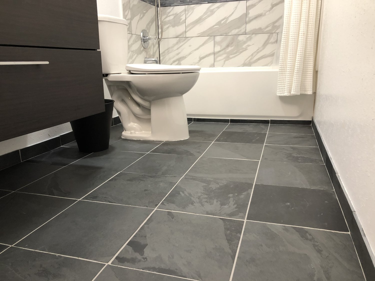 Finished floor with tile baseboards to make the entire floor waterproof!