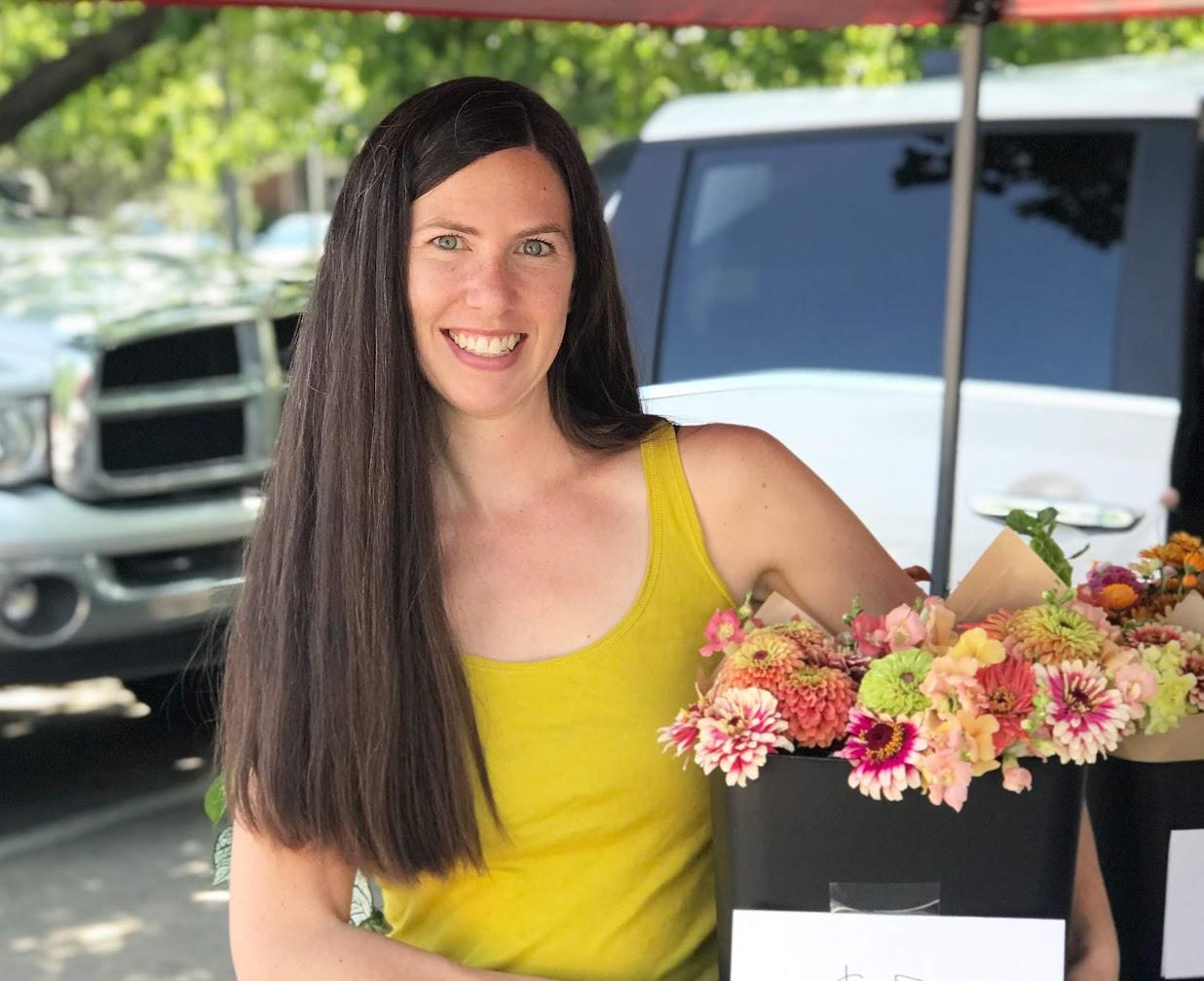 Florist at farmers market.