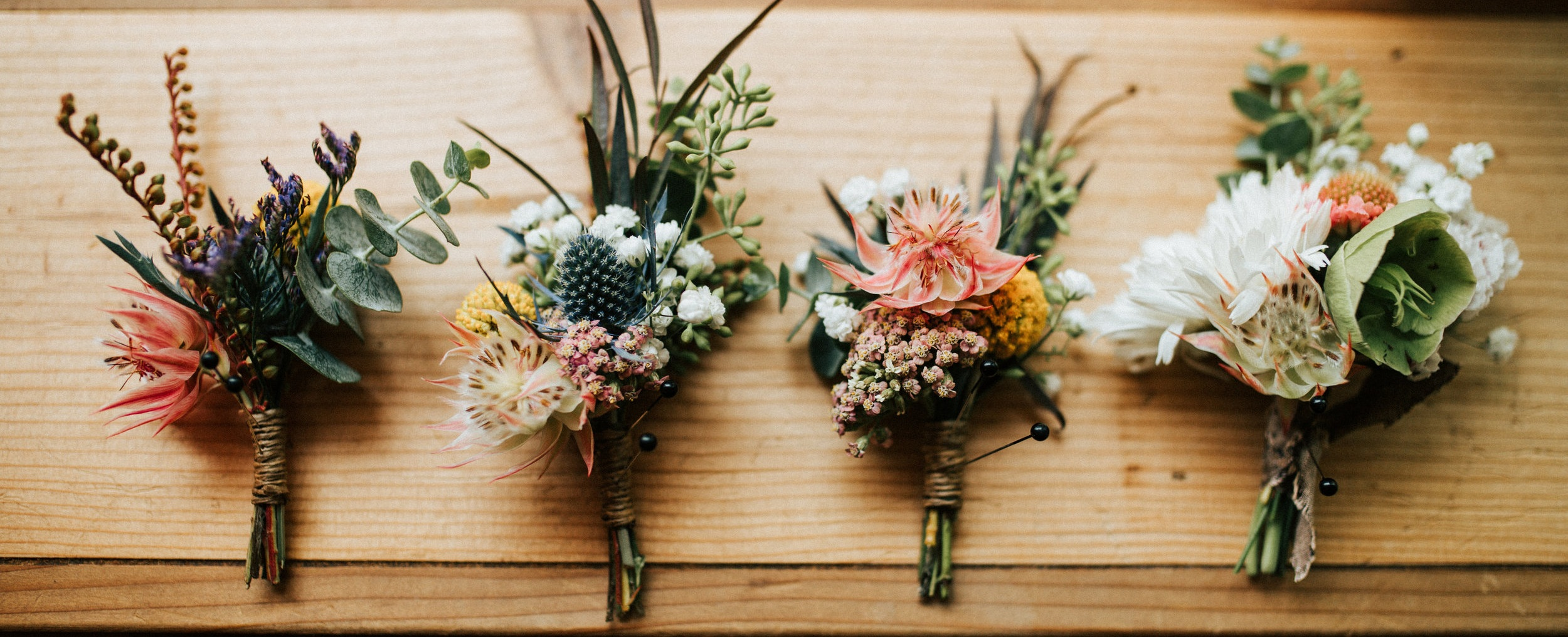 Boutonnieres made by Fort Collins wedding florist.