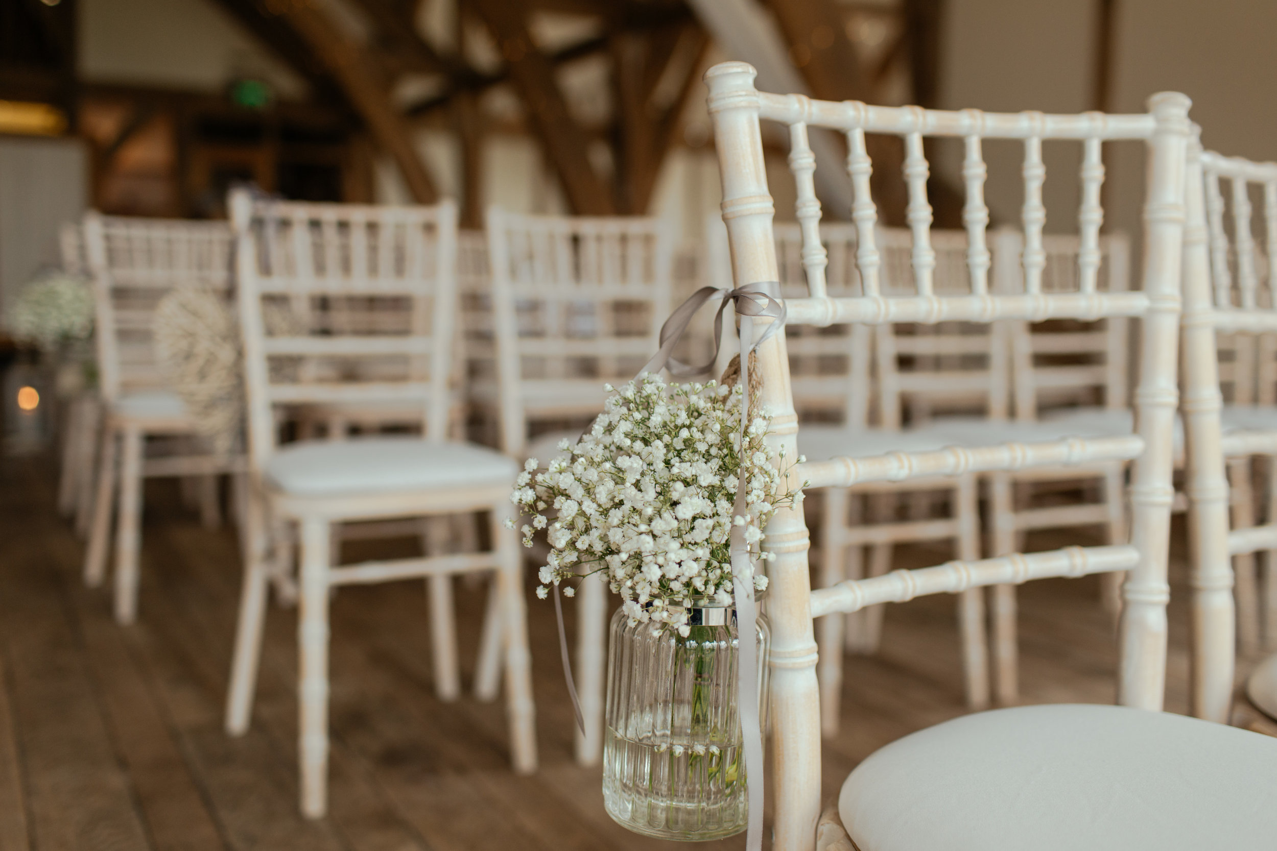Wedding chair flowers designed by farmer-florist.