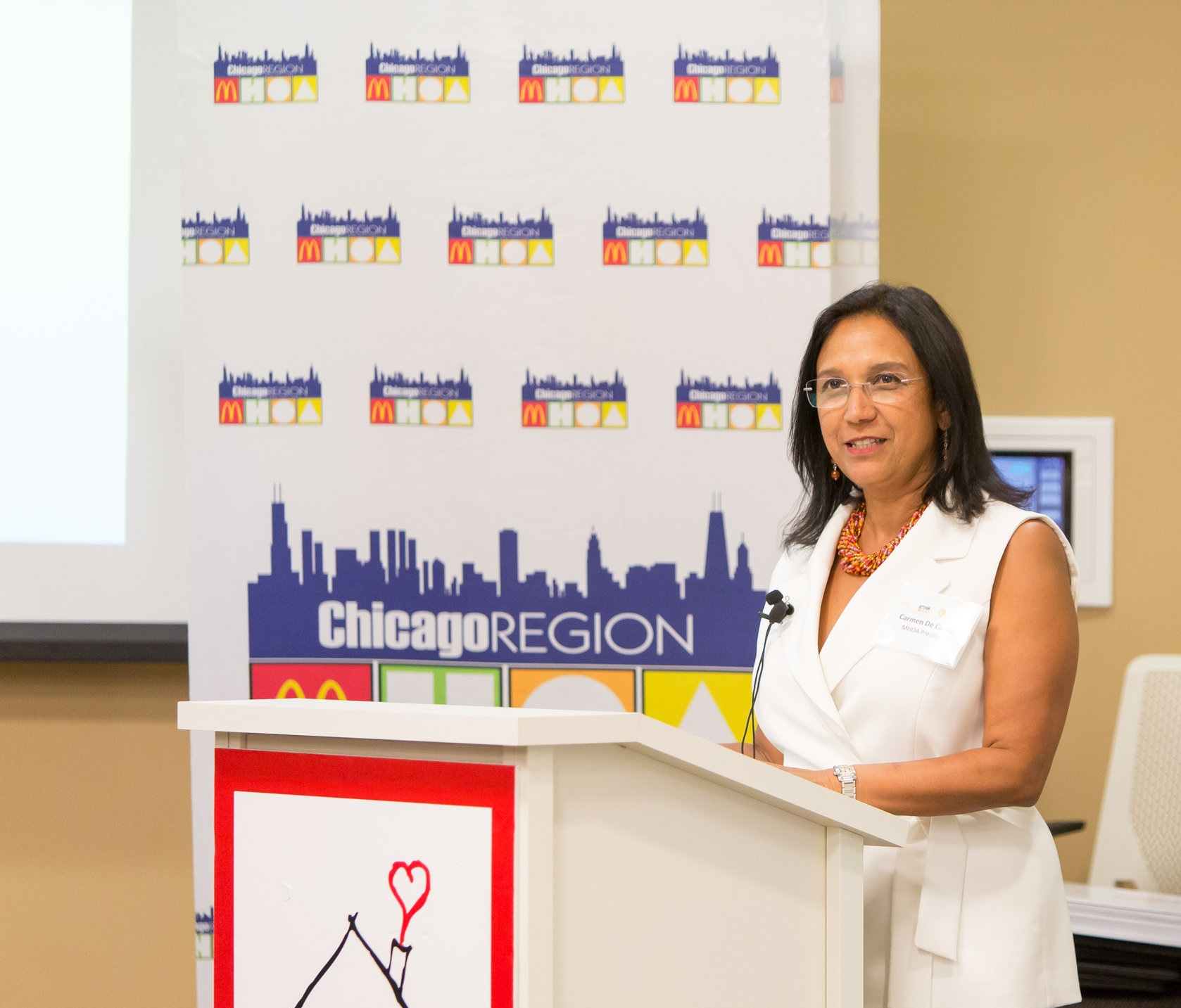 """""""At McDonald's, we are strongly committed to motivating local Hispanic students to earn a college degree"""". - — Carmen Solano-DeCarrier president of The McDonald's Hispanic Owner-Operators Association of Chicago and Northwest Indiana."""