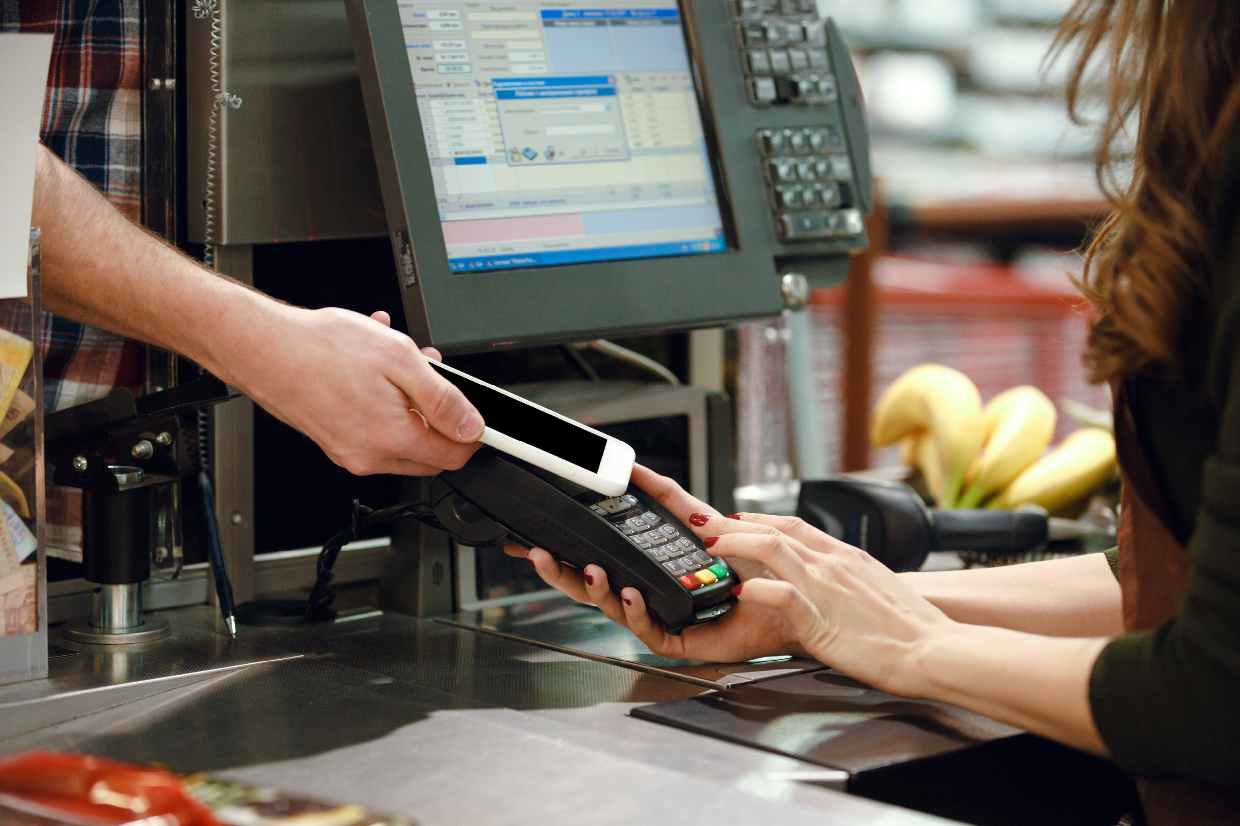 cropped-image-of-cashier-woman-create-payment-PQAUMU3.jpg