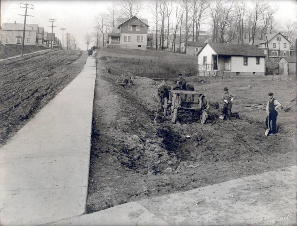 BREAKING-GROUND-FOR-B-G-COOK-HARDWARE-CORNER-OF-15TH-ST.-KENMORE-BLVD.-1917-1030x784.jpg