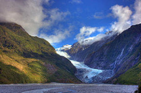 Franz josef Glacier seen from bellow a river valley