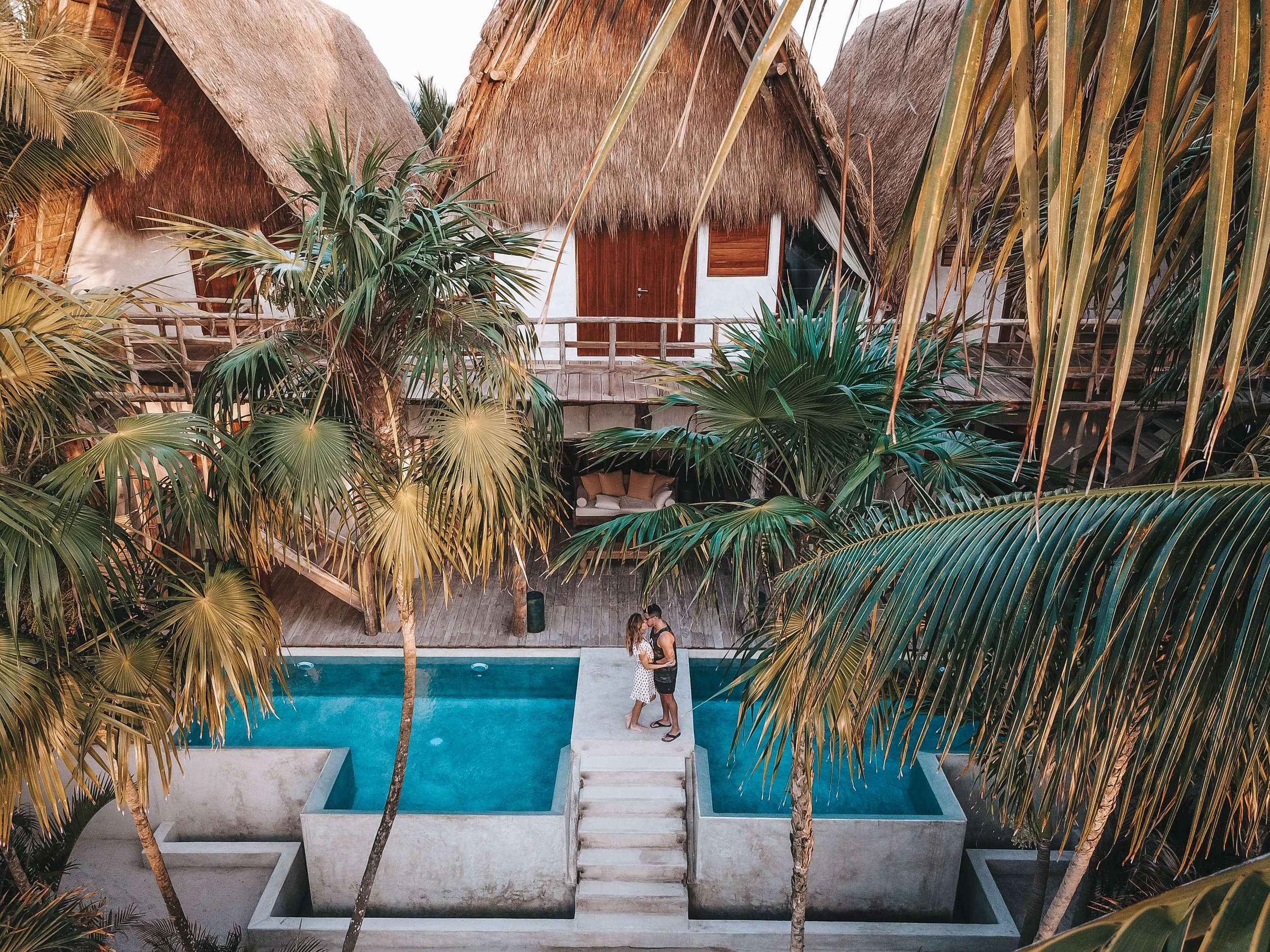 image of couple traveling and staying at a tropical resort with palm trees
