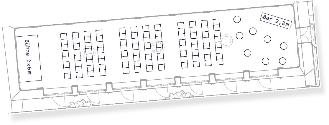 Konferenz Setting im ViENNABALLHAUS mit Sesselreihen und Bar-Bereich