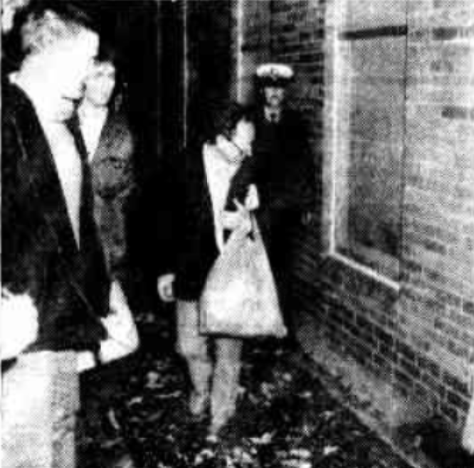 Carrying a blanket and followed by police, Mr O'Shannassy tries to find a way into the building.