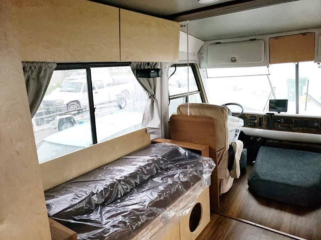 I cant believe how dark and dingy this place was! . Swipe to see the before! 👉🏼 I dont know how we did a walk through of that RV and saw so much potential 😅 it's seriously amazing that we just *knew* that was going to be our home. . Took out the old carpet, replaced it with click n lock waterproof vinyl plank. Built our own convertible furniture, including our couch/guestbed/storage combo. We used 3 different paint colors and a brighter wood (birch) for the cabinetry. . This is our loving room, drivers side. Pictured is our couch, upper cabinets, part of our pantry, new flooring, the painted and restored cab, and the handmade curtains. . What's your favorite part that you can point out? . . . #wanderlustlife #worldlust #roamtheworld #wandertheworld #passportcollective #getlostnow #luxuryrvrenovator #rvdesign #rvfixerupper #rvdecor #makingrvspretty #moderncamper #motorhomelife #classamotorhome #lifeontheroad #dreambiglivetiny #dreambigtravelmore #woodporn #vancrush #declutter #decluttering #vintagecamper #rvremodel #rvreno #liveriveted #skoolielife #skoolieconversion #simpleliving #destinationearth #cozyonwheels