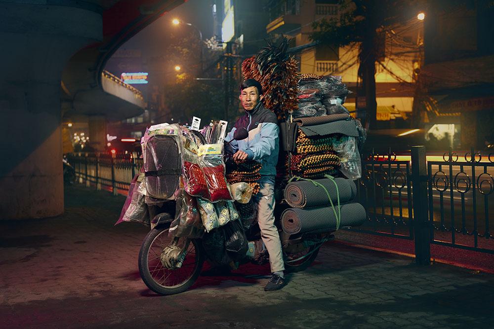 Motorbikes carry goods around the city of Hanoi, Vietnam. 2019 Jon Enoch