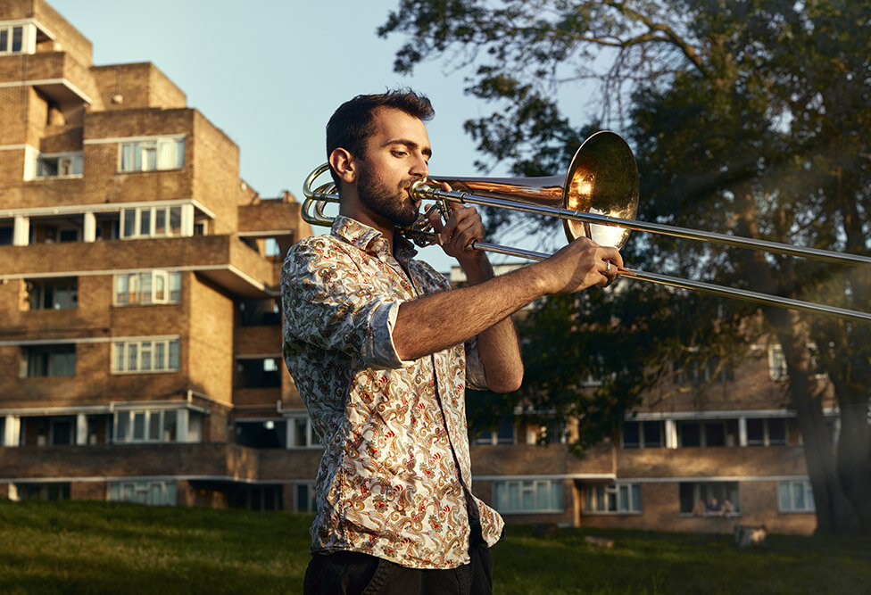 Rehearsal Room by Photographer Jon Enoch. Pictured: Yusuf Oliver Narcin and his bass trombone, East Dulwich, London.
