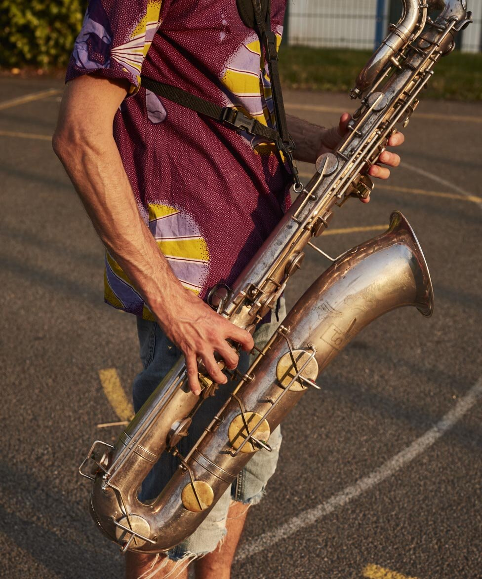 Rehearsal Room by Photographer Jon Enoch. Pictured: Leroy Richardson and his baritone saxophone pictured in East Dulwich, London.