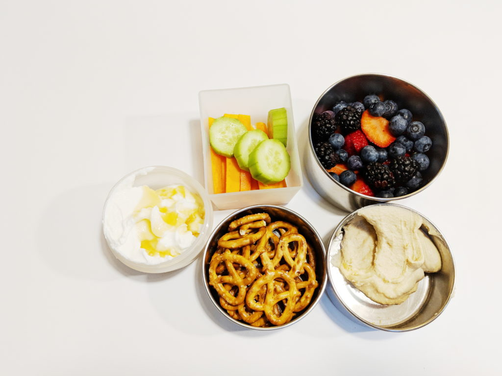 Hummus; pretzels; greek yogurt with honey; veggies & berries.