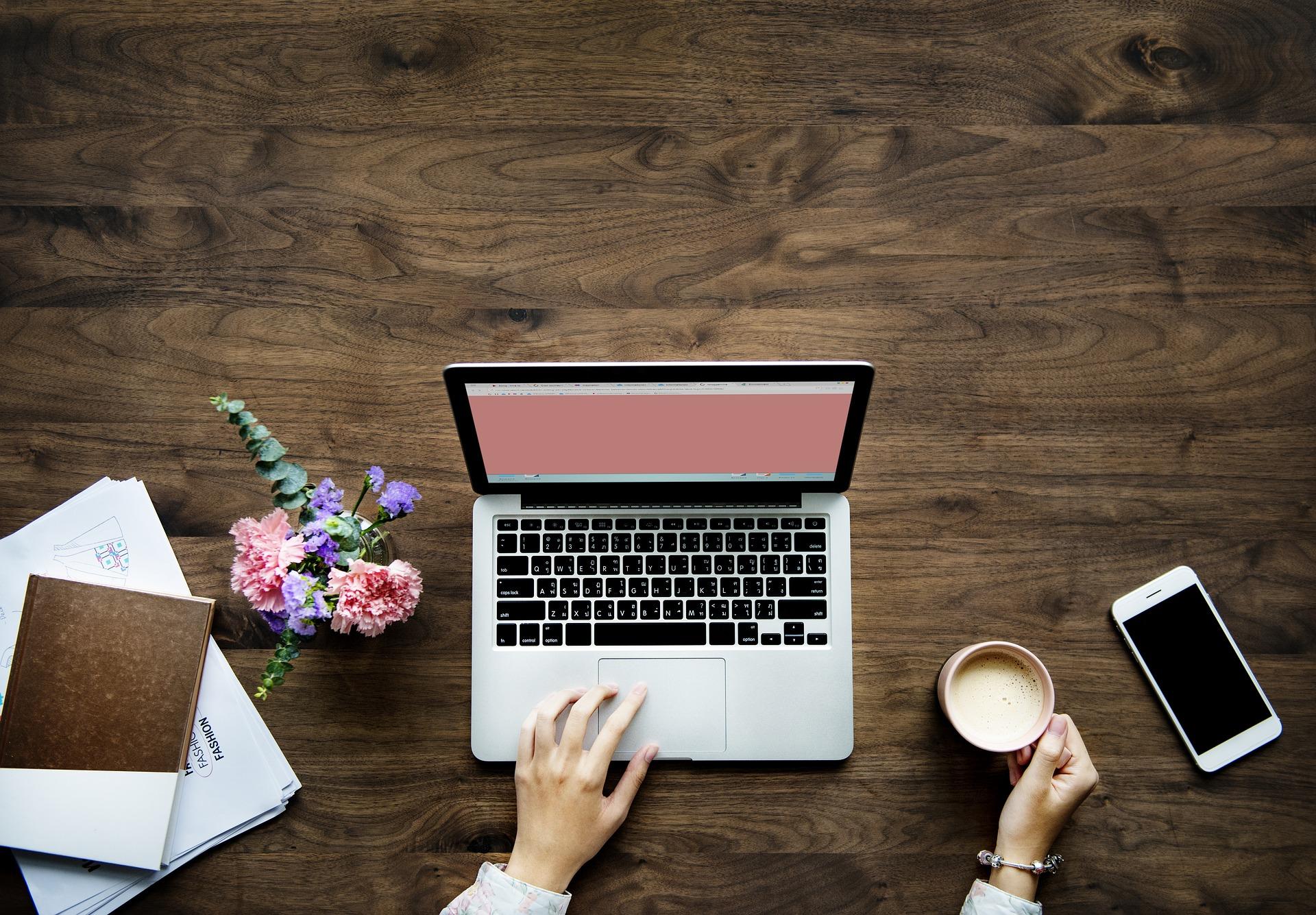 content marketing laptop coffee flowers