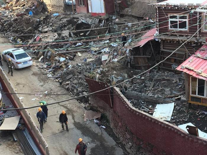 Buildings by the side of one of Larung Gar's main roads after demolition