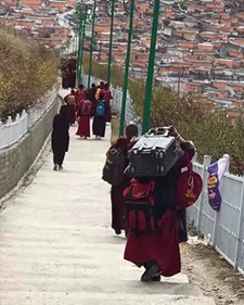 Residents leaving Larung Gar with their possessions