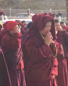 Monks and nuns of Larung Gar praying and crying because of the forced evictions and demolitions of their homes in 2016