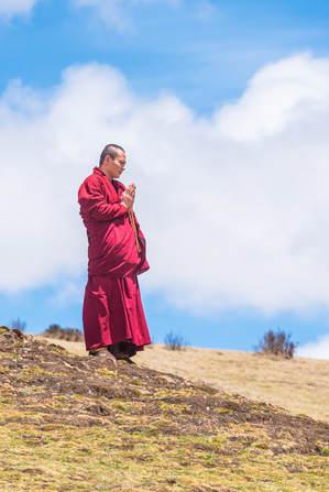 Monk praying during a sky burial at Larung Gar in 2016 (Jesse Rockwell)