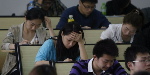 People take part in the civil service examination at Huazhong University of Science and Technology on April 24, 2011 in Wuhan, Hubei Province of China.