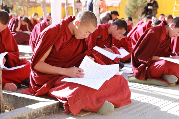 Monk taking a Chinese law exam. Ganden Monastery in Lhasa.