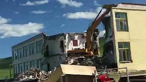A Tibetan building is torn down near Qinghai Lake