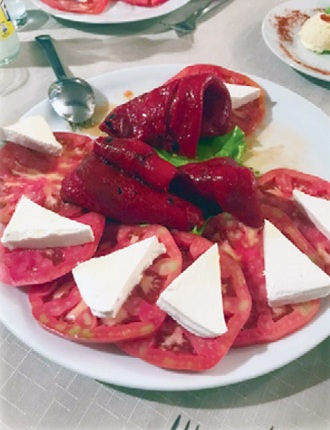 Fresh tomatoes, roasted red peppers, and farmer cheese is common in Bulgaria.