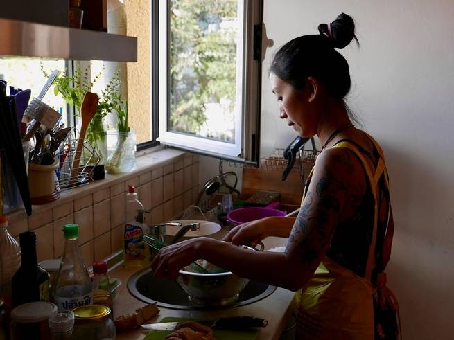 Kim Kim Dao makes Pho Ga for customers in her small apartment in Sofia, Bulgaria.